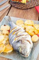 baked fish with lemon and potatoes photo