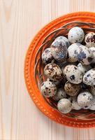 Quail eggs in wicker bowl