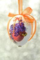 Decorated Easter egg made by decoupage technique on bokeh background