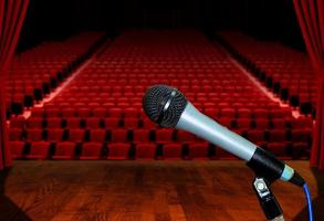 Microphone on Stage Facing Empty Auditorium Seats photo