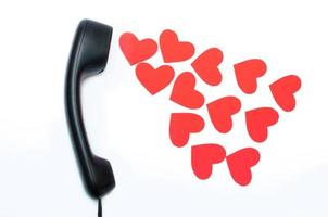 Black phone headset with many carton hearts photo