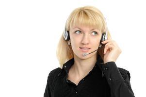 Young female customer service representative in headset. photo