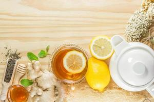 tea with mint honey ginger and lemon on wood background