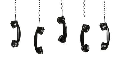 Retro telephones hanging by their phone cords photo