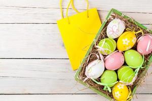 Easter background with colorful eggs and gift bag photo