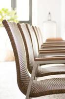 Wicker chairs arranged in a conference room