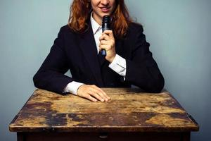Woman in suit giving lecture photo