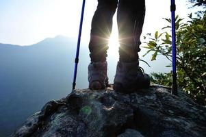 hiking legs sunrise mountain peak photo