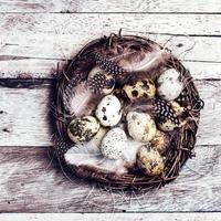 Easter basket with  Eggs on wooden background.