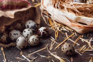 Quail eggs on wooden table