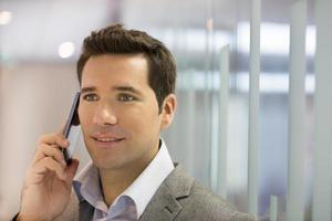 Successful businessman talking on cell phone