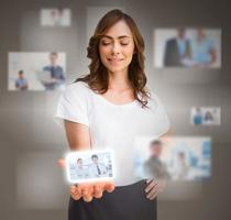 Businesswoman presenting picture of coworkers photo