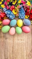 Spring flowers and colored eggs. Easter decoration photo