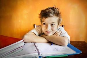 young boy concentrating on homework photo