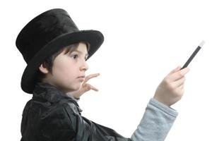 young magician concentrated on the trick he is performing photo