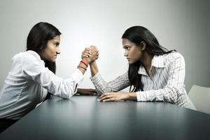 Business co-worker's arm wrestling for control.