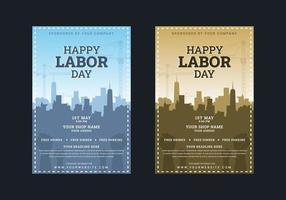 Cartel del día del trabajo con edificios y manos levantadas vector