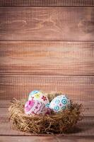 Colorful easter eggs in nest photo