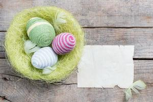 Easter eggs decorated with woolen threads