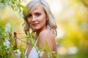 blonde woman in a flowered garden photo