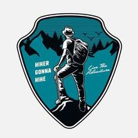 Shield emblem with mountain scene and hiker vector