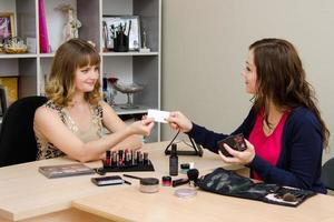 Beauty consultant business card transmits office staff