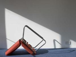 Upturned Office Chair Casting Shadow On Wall photo