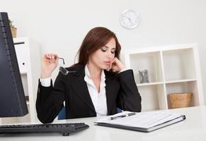 Businesswoman thinking at workplace