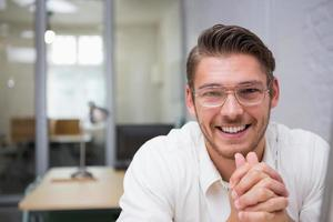 Cheerful young businessman at office photo