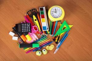 Big set of bright office supply and alarm clock