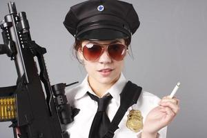 Female police officer with cigarette and gun