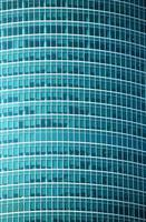 Modern office building glass wall front view close-up photo