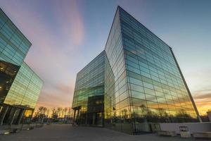 Modern office building in the evening photo