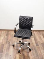 Black leather armchair in office room