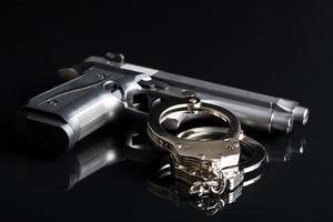 handcuffs and handgun