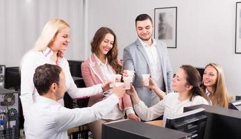 Business team celebrating project close-out photo