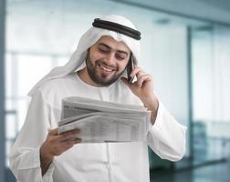 arabian business man reading newspaper in the office