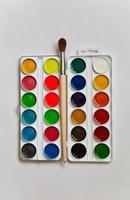Watercolors and brush photo