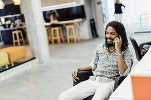 Handsome designer smiling while working in an office