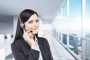 upport phone operator in headset. Modern panoramic office.