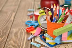 Multicolored pencils in a bucket