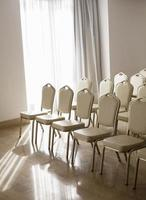 Empty chairs in empty room