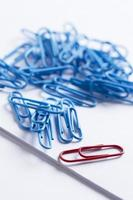 Paperclips scattered on white surface