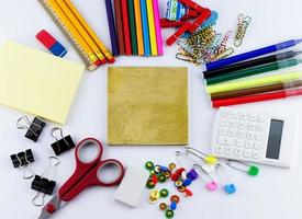 Top view of blank board with school and office supplies photo