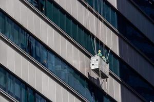High-Rise Window Cleaners in Singapore working on Skyscraper