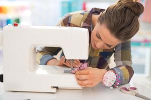 seamstress sewing in studio photo