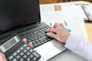 Accountant woman working on financial results photo