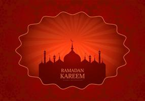 Red Ramadan Kareem card with glowing mosque silhouette