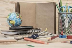 multiple stationery and notebook on table for school