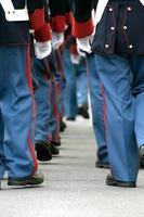 soldiers walking away photo